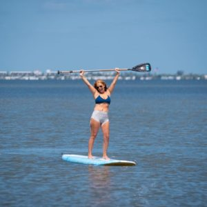 woman renting a paddleboard from wildlife watersports