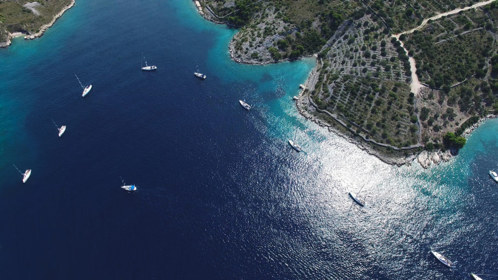 boating in a tropical bay from above